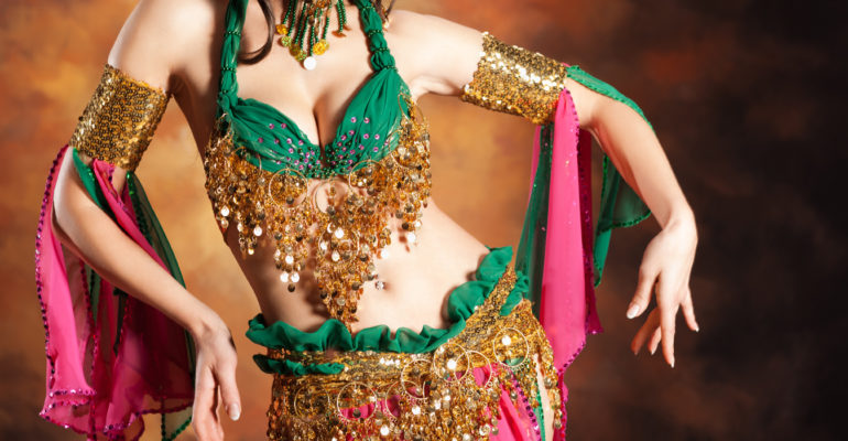 Beautiful exotic belly dancer woman a rot-green costume